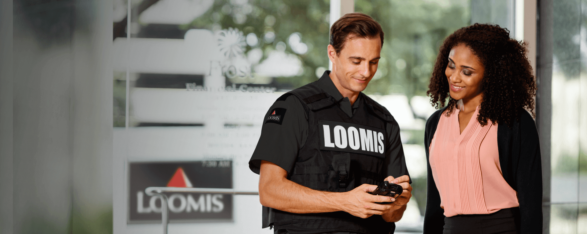Loomis employee meeting with a customer
